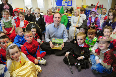 Philip Bell with children at Holy Cross School IOW - Photo:  Isle of Wight County Press Copyright 2012