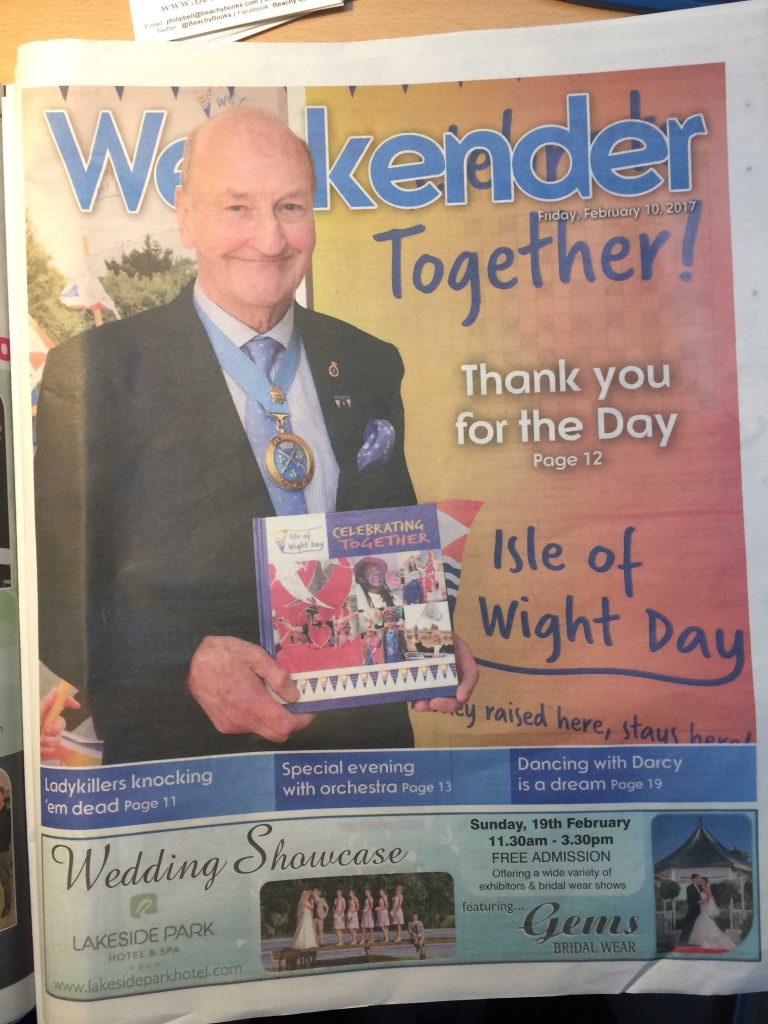 Celebrating Together - Weekender front cover showing robin Courage holding book - IWCP Feb 10th 2017 - web